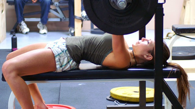 woman performing a bench press
