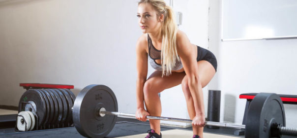 Woman at the bottom of a deadlift