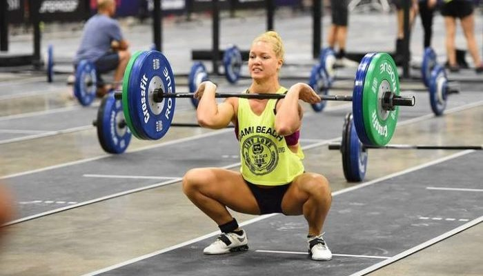 Woman in a crossfit competition doing a front squat