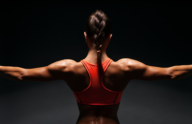 Woman with defined back muscles