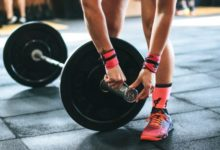 woman weight training for fat loss